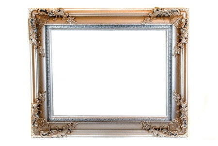 empty vintage ornamented wooden picture frame isolated photo