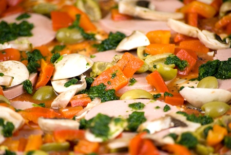 close up of colorful homemade pizza ready to be baked photo