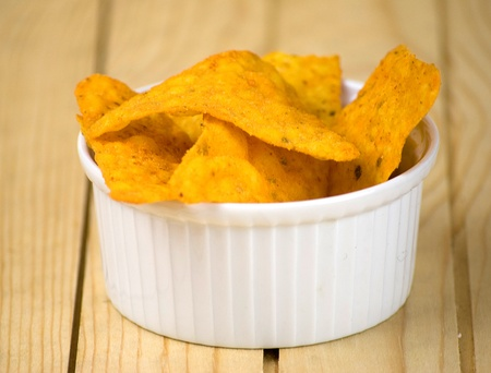 corn chip: spicy tortilla chips  over wooden board