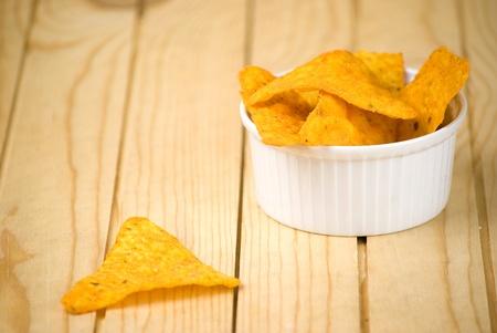 corn tortilla: spicy tortilla chips over wooden board
