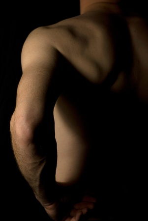 naked male: sexy fit naked male body on black background low key