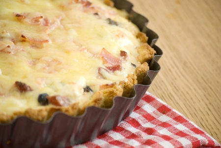 quiche with ham cheese salami muchrooms beans eggs in a tray Stock Photo - 13628682