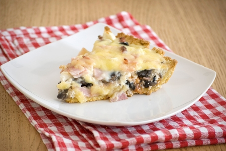 quiche with ham cheese salami muchrooms beans eggs in a white plate Stock Photo - 13628699