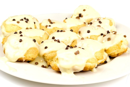 french homemade eclairs decorated in a white plate photo