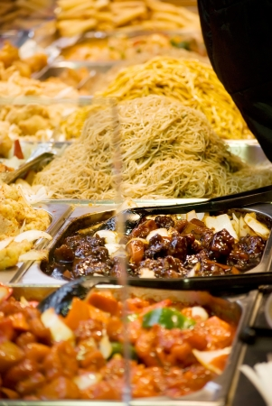 Freshly prepared oriental dishes on a market stall photo