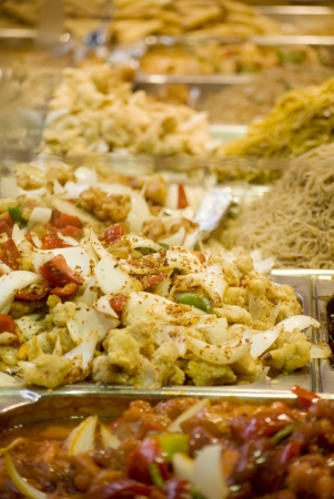 Freshly prepared oriental dishes on a market stall Stock Photo - 13725878
