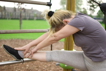 middle aged woman keeping fit with exercises in a park Stock Photo - 13725553