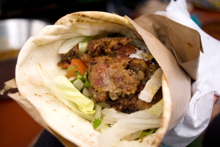 beef wrap with fresh vegetables on a market photo