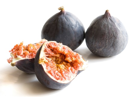 laxative: fresh organic figs over white background close up Stock Photo