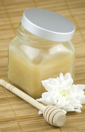 relaxing aroma of almond coconut vanilla milk and honey bath foam over wooden mat photo