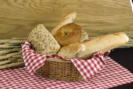 variety of different freshly baked bread in baskets photo