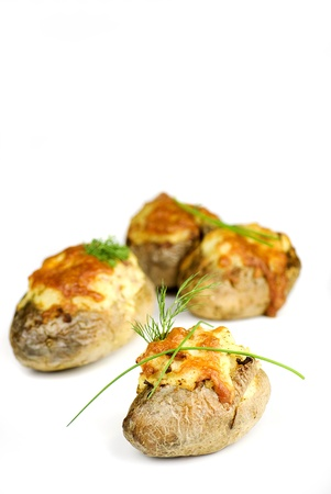stuffed potatoes covered with cheddar cheese decorated with chives and dill leaves in a white plate Stock Photo - 14393991
