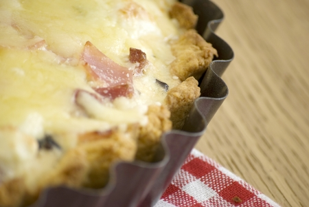quiche with ham cheese salami muchrooms beans eggs in a tray Stock Photo - 14394058