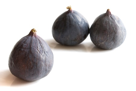 fresh organic figs over white background close up photo
