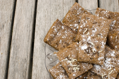 homemade ginger cookies over wooden table with fresh ginger root photo