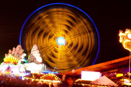 long exposure pictures of amusement park rides and wheels at night Stock Photo - 17208756