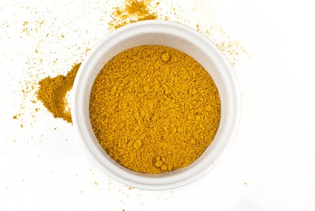 curry powder: ground curry spice isolated on white background Stock Photo