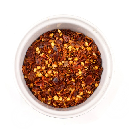 pepper flakes: dried chilli flakes isolated on white background Stock Photo