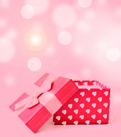 red gift box with hearts on bukeh background photo