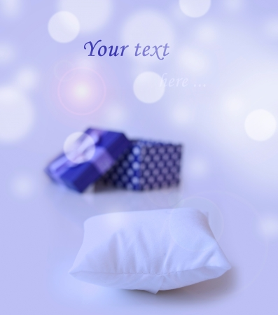 blue jewellery box with ribbon in bukeh background with little pillow to put your ring on photo