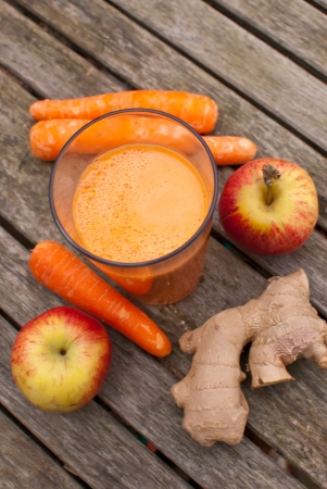 healthy juice made of freshly juiced fruits and vegetables photo