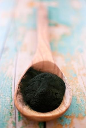 organic spirulina algae powder in wooden spoon Stok Fotoğraf - 18007012