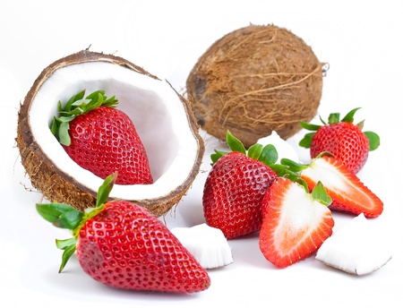 healthy fresh fruits - strawberries and coconut isolated on white background