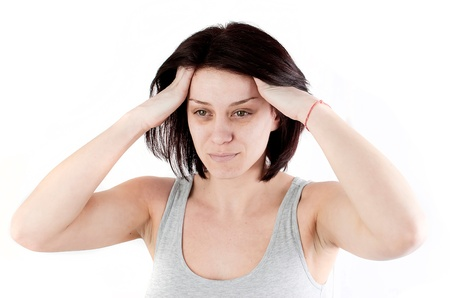 young woman with headache making massage to avoid pain Stock Photo - 18914107