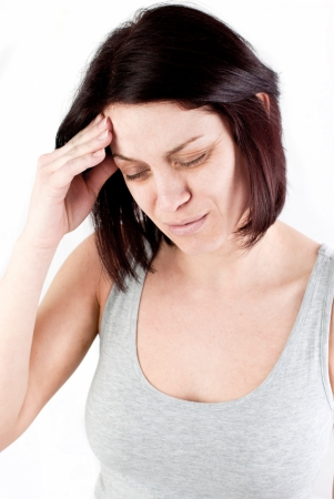 young woman with headache making massage to avoid pain Stock Photo - 18914069