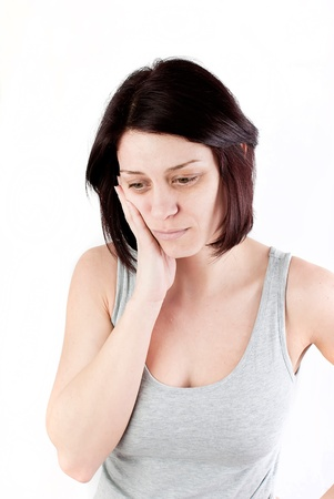 young woman with tooth ache making massage to avoid pain Stock Photo - 18914081