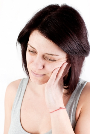 young woman with tooth ache making massage to avoid pain Stock Photo - 18914061