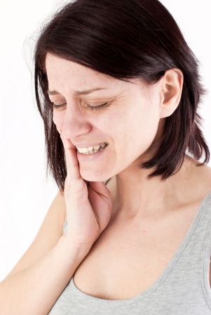 young woman with tooth ache making massage to avoid pain Stock Photo - 18914070