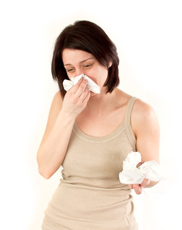 sneezing woman holding tissues, allergy or cold flu concept photo