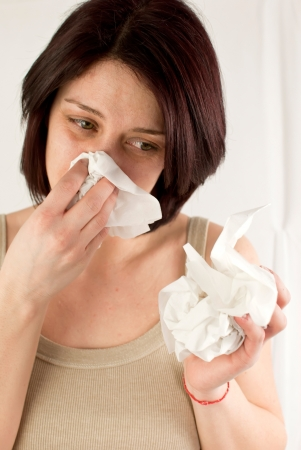 sneezing woman holding tissues, allergy or cold flu concept Stock Photo - 18914080