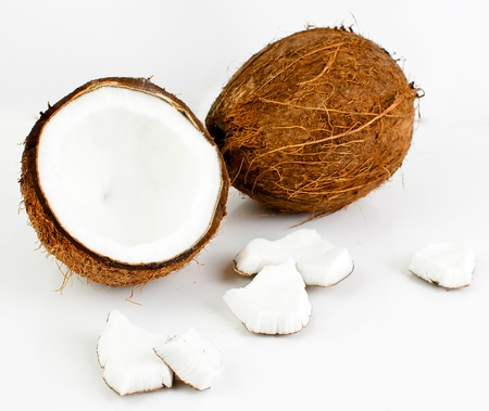 freshly cut coconut and milk isolated on white background photo