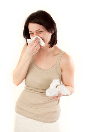 sneezing and laughing allergies ill woman with tissues photo