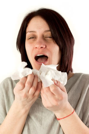 motion blur image of sneezing woman holding tissues, allergy or cold flu concept photo
