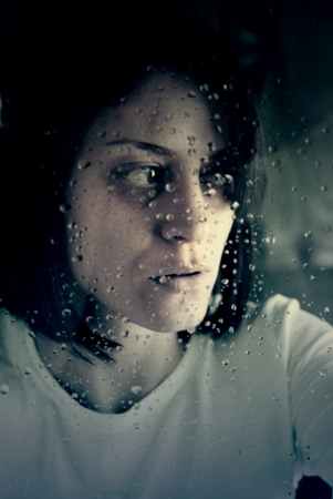 conceptual portrait of stressed abused young woman  photo
