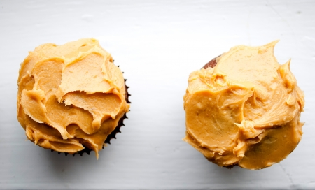 delicious homemade cupcakes with peanut butter icing photo