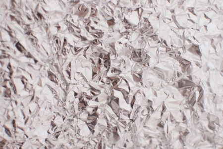 abstract silver rough wrinkle foil texture background photo
