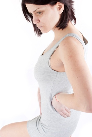 womb: young woman with stomach pain making massage to avoid ache Stock Photo