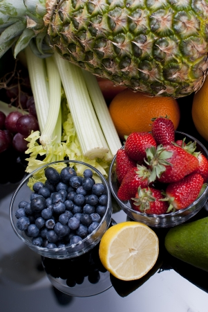 healthy variety of fresh fruits and vegetables photo