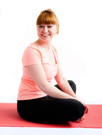 40s adult: middle aged redhead woman exercising yoga isolated on white