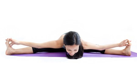 young brunette girl practising yoga isolated on white photo