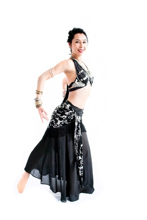 exotic young belly dancer, oriental dance isolated on white background photo