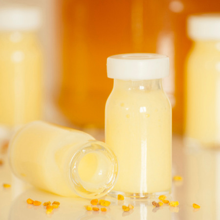 raw organic royal jelly in a small bottle