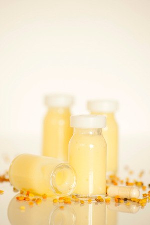 bee pollen: raw organic royal jelly in a small bottle