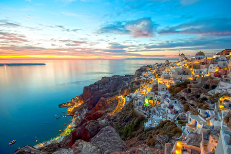 Oia Santorini Greece famous with romantic and beautiful sunsets photo