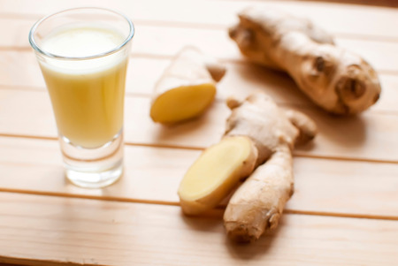 fresh ginger: fresh organic healthy ginger shot juice and root Stock Photo