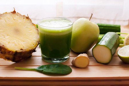 healthy organic green detox juice on wood